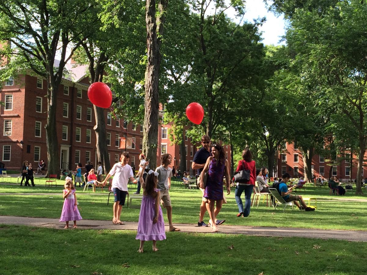 Children Holding Red Balloons On Harvard Yard
